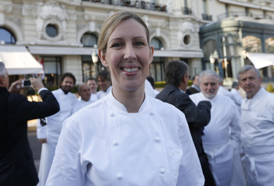 British chef Clare Smyth poses among 240 chefs from 25 countries, representing five continents and 300 stars ranked in the Michelin gastronomy guide, as part of the 25th anniversary of French chef Alain Ducasse's restaurant Le Louis XV, on November 17, 2012 in Monaco.  AFP PHOTO / VALERY HACHE        (Photo credit should read VALERY HACHE/AFP via Getty Images)