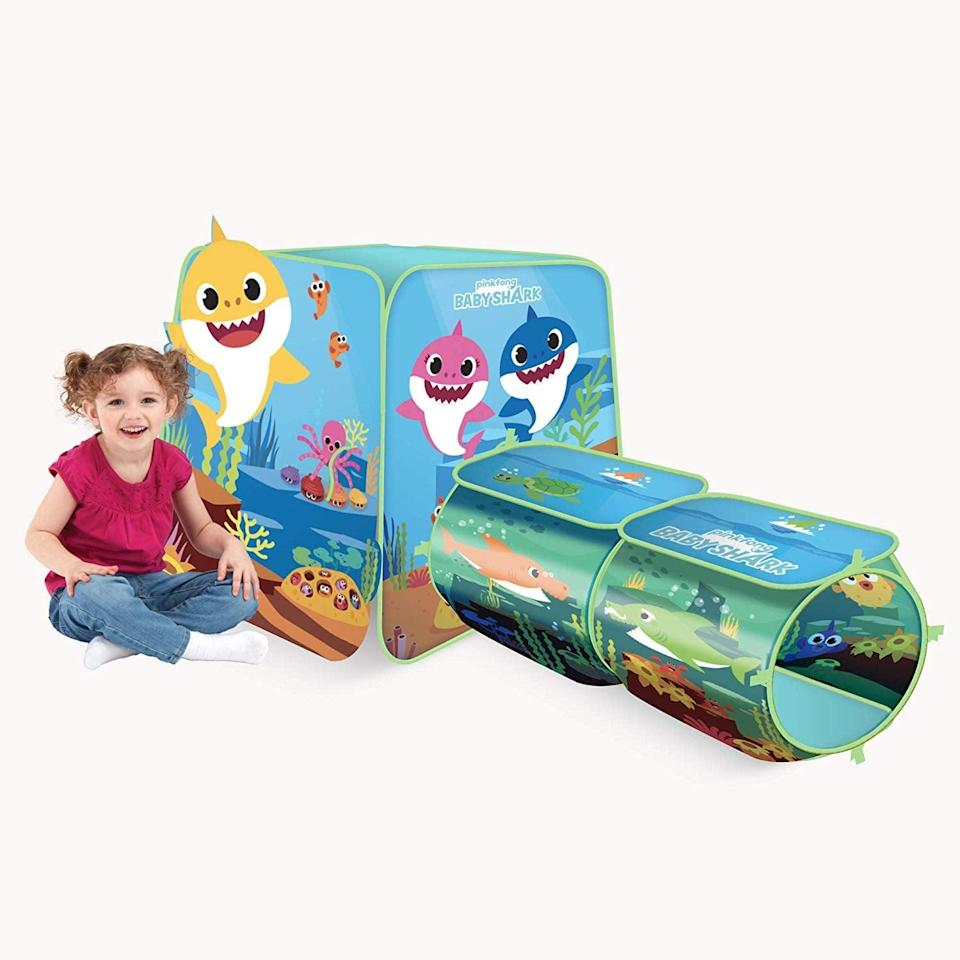 """<p>Your kids can loop in and around this pop-up <a href=""""https://www.popsugar.com/buy/Pinkfong-Baby-Shark-Explore-4-Fun-Play-Structure-511969?p_name=Pinkfong%20Baby%20Shark%20Explore%204%20Fun%20Play%20Structure&retailer=amazon.com&pid=511969&price=37&evar1=moms%3Aus&evar9=45808433&evar98=https%3A%2F%2Fwww.popsugar.com%2Fphoto-gallery%2F45808433%2Fimage%2F45808443%2FBasically-Mini-Playground&list1=toy%20fair%2Ckid%20shopping&prop13=api&pdata=1"""" class=""""link rapid-noclick-resp"""" rel=""""nofollow noopener"""" target=""""_blank"""" data-ylk=""""slk:Pinkfong Baby Shark Explore 4 Fun Play Structure"""">Pinkfong Baby Shark Explore 4 Fun Play Structure</a> ($37), or turn it into a cozy reading nook!</p>"""