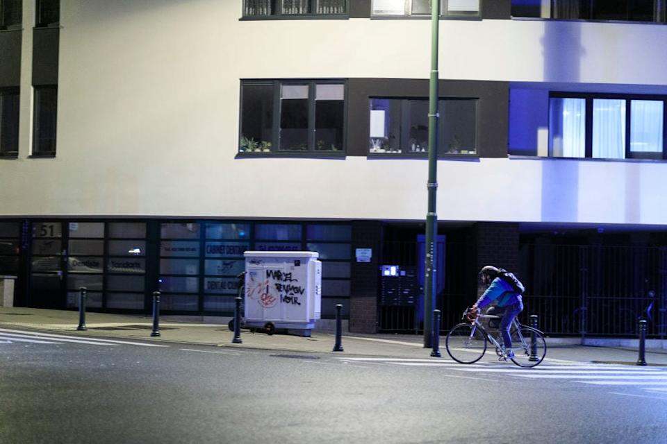 A cyclist rushes home to beat the curfew in Brussels - getty