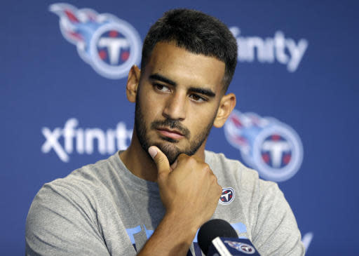 Tennessee Titans quarterback Marcus Mariota answers questions during a news conference Monday, April 15, 2019, in Nashville, Tenn. The Titans are trying to figure out how to improve after three straight 9-7 seasons as the team begins their offseason program. (AP Photo/Mark Humphrey)