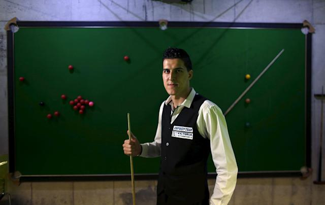 Ivaylo Pekov, 21, the only Bulgarian who competed in the World Snooker Championship poses for a picture in Sofia, Bulgaria April 30, 2015. Ten years ago there was not a single full-sized snooker table in Bulgaria and the majority of people in the Black Sea state would not have heard of the sport, let alone played it. But the country has now hosted a Challenge Tour Event three years in a row and Bulgarian Pekov recently became only the second eastern European to compete in the world snooker championship qualifying rounds.Picture taken April 30, 2015. REUTERS/Stoyan Nenov