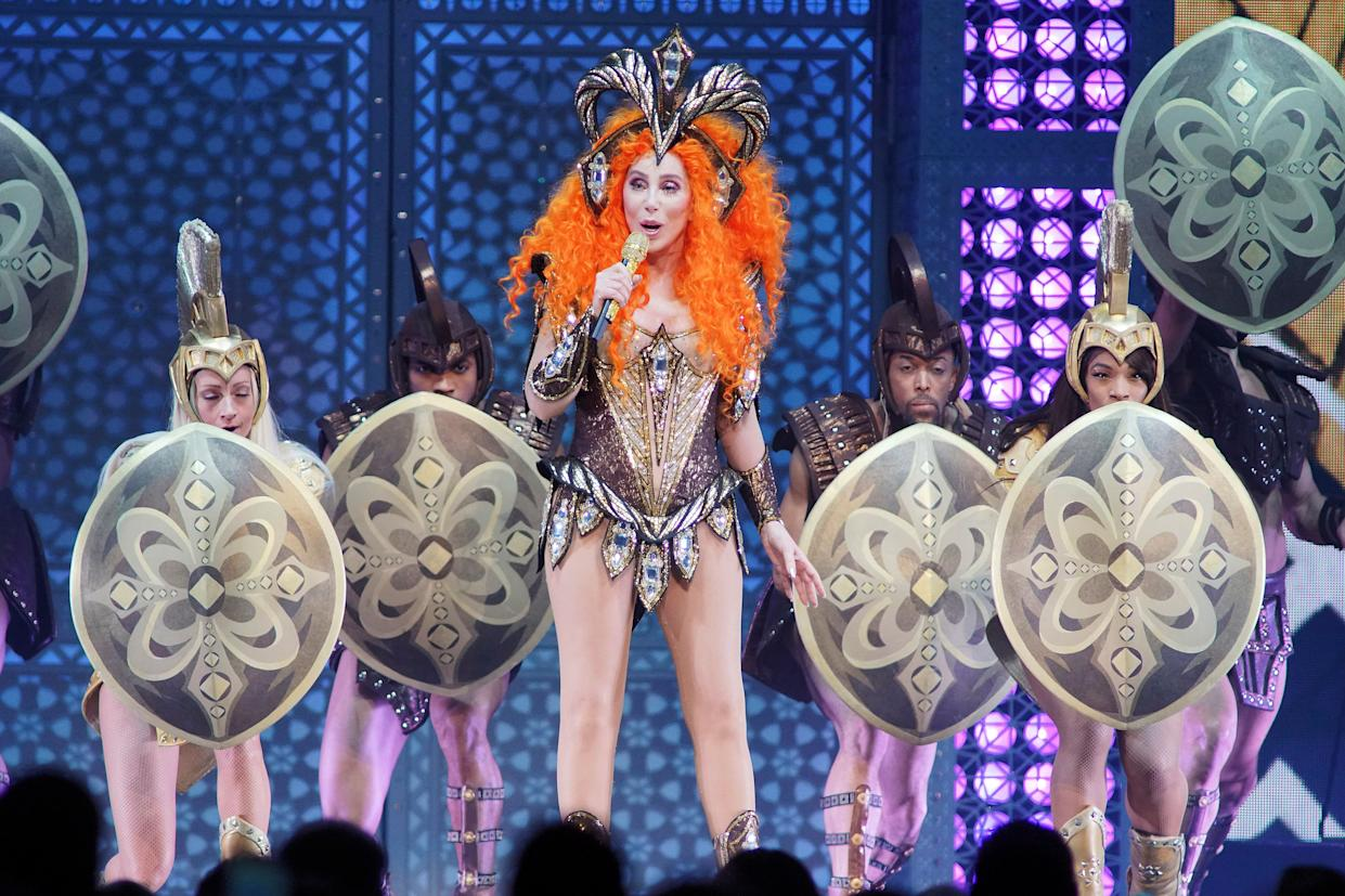 """Cher performs during the """"Here We Go Again,"""" tour at the Fiserv Forum, Sunday, May 12, 2019, in Milwaukee. (Photo by Rob Grabowski/Invision/AP)"""