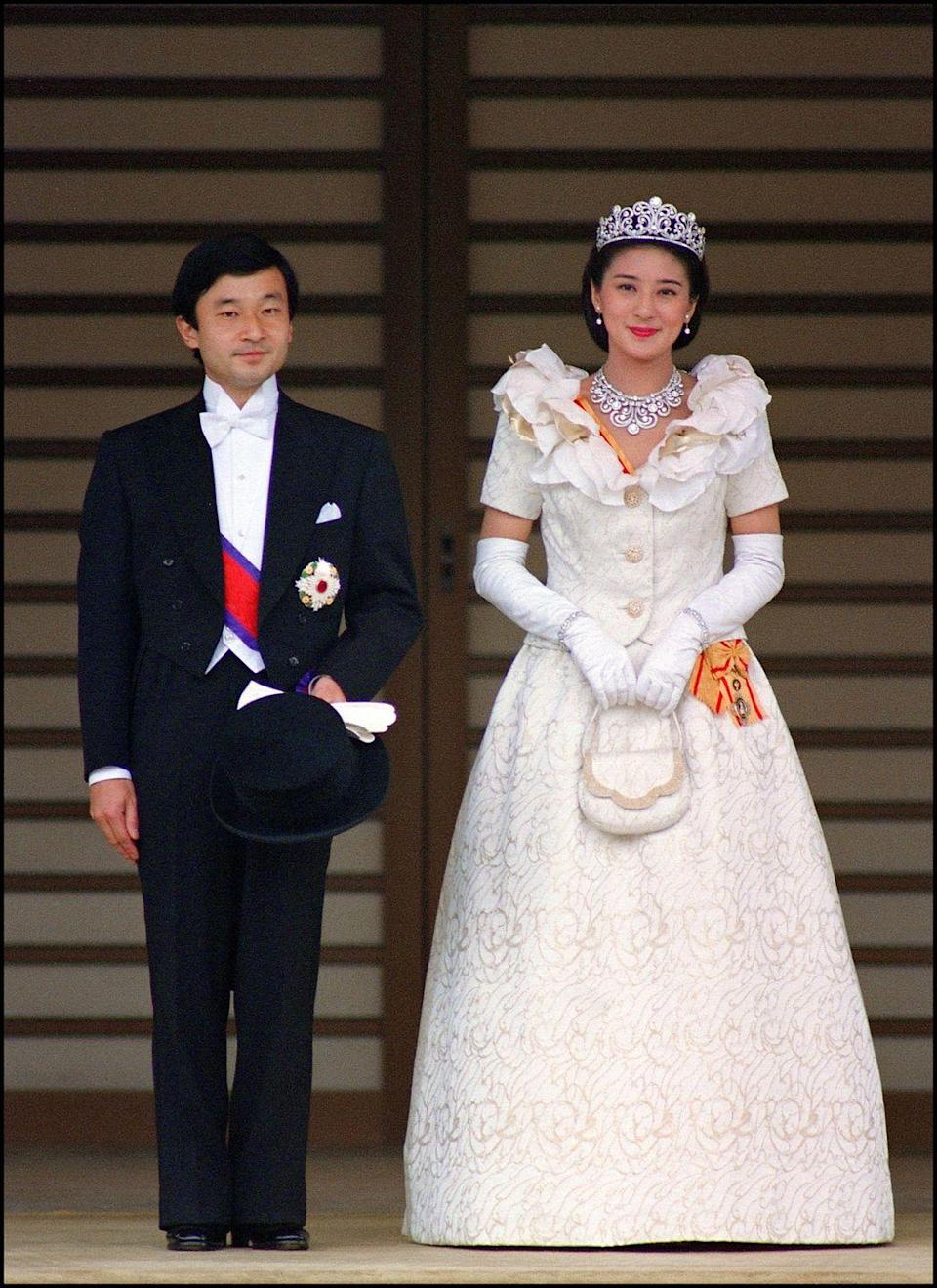 <p>Princess Masako of Japan wore an ivory gown with a large, ruffled neckline on her wedding day. She and Prince Naruhito held their wedding at the Shinto shrine of Amaterasu, the Sun Goddess, on the grounds of the Imperial Palace in Tokyo, Japan on June 9, 1993.</p>