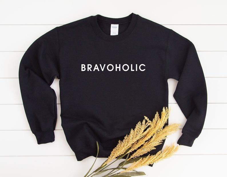 <p><span>Bravoholic Sweatshirt</span> ($28) is s cozy find for those days you just want to chill in bed with Bravo TV.</p>