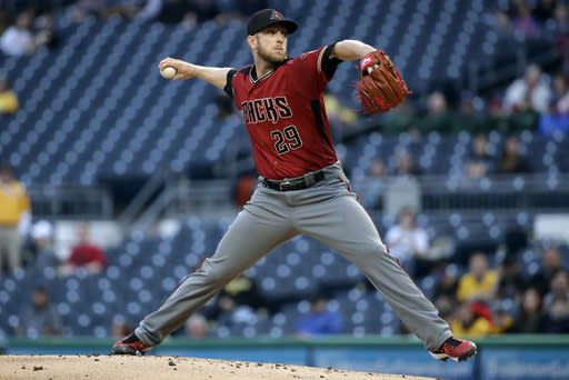 Arizona Diamondbacks starting pitcher Merrill Kelly delivers in the first inning of a baseball game against the Pittsburgh Pirates in Pittsburgh, Wednesday, April 24, 2019. (AP Photo/Gene J. Puskar)