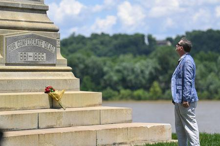 James Callan, of Louisville, Kentucky, stands in front of a Civil War Confederate Soldier Memorial in Brandenburg, Kentucky, U.S. May 29, 2017. The Memorial was recently removed from the campus of the University of Louisville.  REUTERS/Bryan Woolston