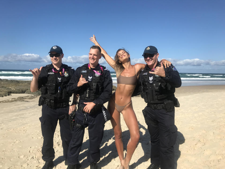 Kristina paused a shoot to take a snap with some cops on the Gold Coast Photo: Supplied