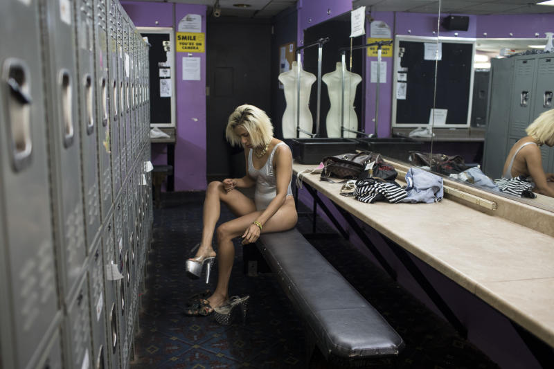 July 2018 - Liset in Austin Texas, preparing for a shift at the strip club where she works. (Photo: Lisette Poole)