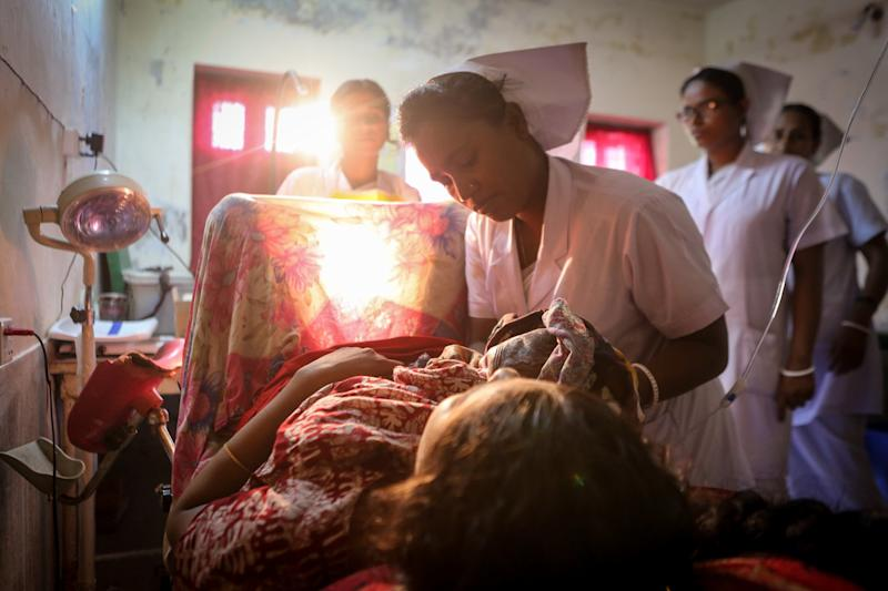 A midwife delivers a baby in Bangladesh. (WaterAid)