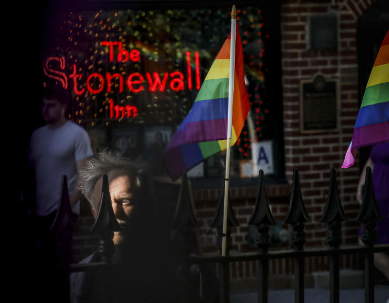"""Gay rights activist Jim Fouratt stands across the street from The Stonewall Inn bar, as he prepares for a late afternoon interview, in New York on June 3, 2019. Fouratt witnessed an arrest at the bar on the night of June 27, 1969, that foreshadowed a series of violent confrontations between the New York Police Department and the bar's gay patrons, sparking a movement for gay rights. """"I see this police car in front of the Stonewall,"""" said Fouratt. """"Suddenly the door opens and this one police officer comes out...he's got a very stocky woman dressed as a man."""" An uproar followed outside from a growing crowd of gay onlookers that lead to a six-day """"rebellion"""" often called the Stonewall riots. (Photo: Bebeto Matthews/AP)"""
