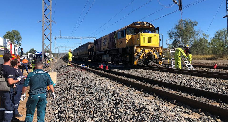 Rescue personnel attending the scene of a train collision near Westwood, 50km west of Rockhampton. Source: AAP