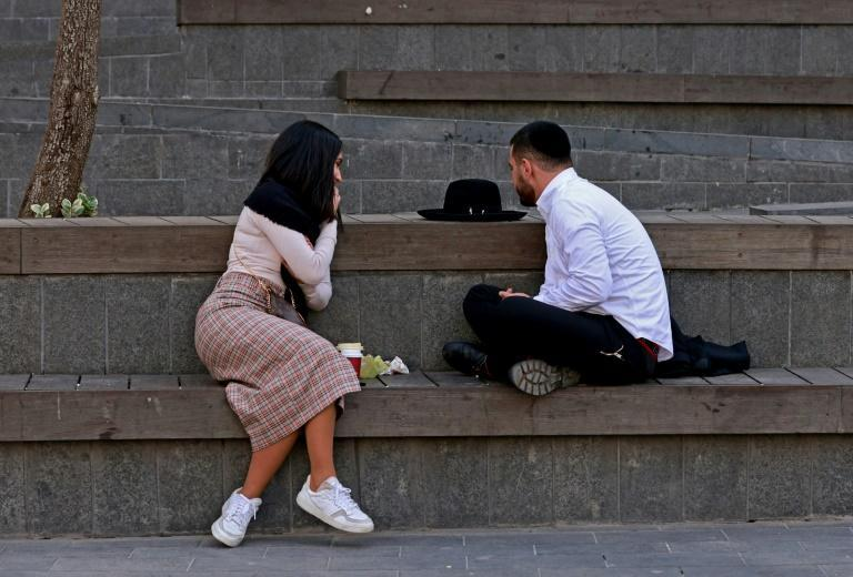 The rituals of pre-marriage courtship for ultra-Orthodox Jews are strictly codified; in this photograph an ultra-Orthodox man and a woman chat outside in a plaza in Jerusalem