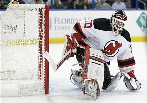 New Jersey Devils goalie Martin Brodeur (30) makes a skate save on a shot by the Tampa Bay Lightning during the second period of an NHL hockey game, Friday, March 29, 2013, in Tampa, Fla. (AP Photo/Chris O'Meara)