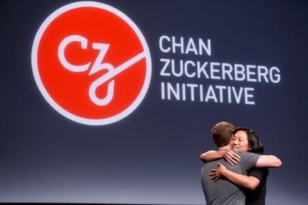 """Pricilla Chan (R) embraces her husband Mark Zuckerberg while announcing the Chan Zuckerberg Initiative to """"cure, prevent or manage all disease"""" by the end of the century during a news conference at UCSF Mission Bay in San Francisco, California, U.S. September 21, 2016.  REUTERS/Beck Diefenbach     TPX IMAGES OF THE DAY"""