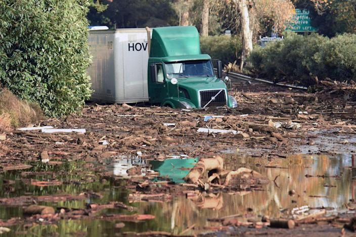 <p>A semi-tractor trailer sits stuck in mud on U.S. Highway 101, in Montecito, Calif. on Tuesday, Jan. 9, 2018. (Photo: Mike Eliason/Santa Barbara County Fire Department via AP) </p>