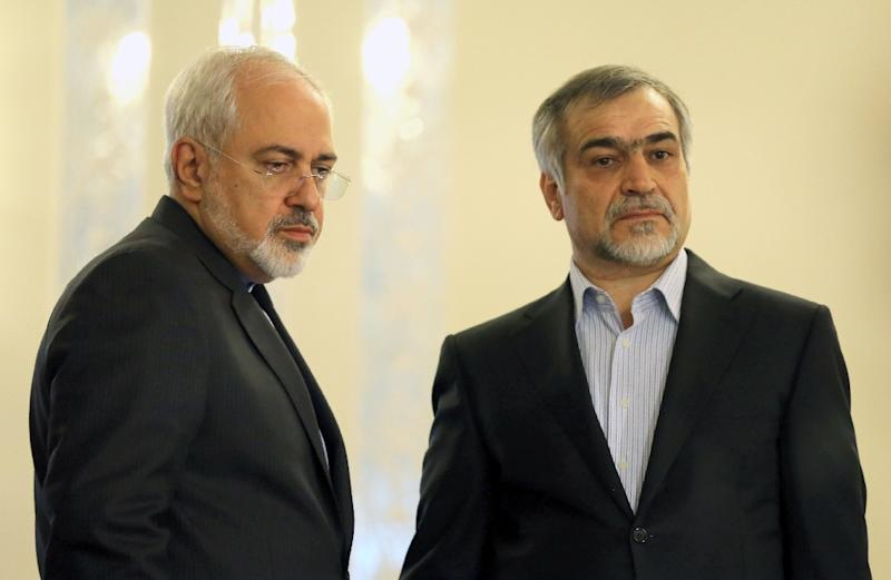 Iranian President Hassan Rouhani's younger brother Hossein Fereydoun (R), shown here with Foreign Minister Javad Zarif, has been arrested on financial crimes charges