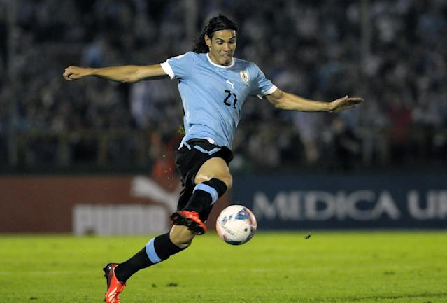 FILE - In this Sept. 10, 2013, file photo, Uruguays Edinson Cavani controls the ball during a 2014 World Cup qualifying soccer game against Colombia in Montevideo, Uruguay. Uruguay has won the World Cup twice _ in 1930 and 1950 _ and is always a dangerous rival with a tough-nosed style of play and two of the world's top forwards in Luis Suarez and Edinson Cavani. (AP Photo/Matilde Campodonico, File)