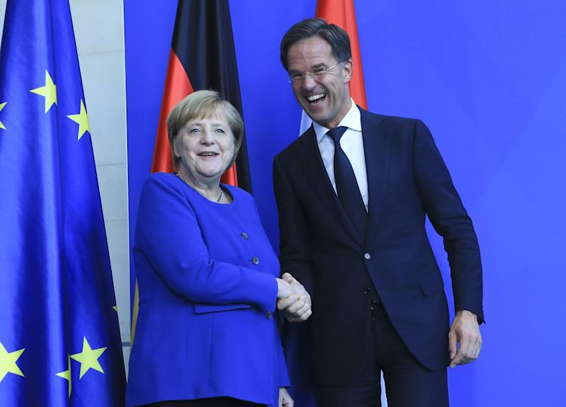 BERLIN, GERMANY - OCTOBER 02 : German Chancellor Angela Merkel (L) and Dutch Prime Minister Mark Rutte (R) pose for a photo before holding a joint press conference after their meeting at the Prime Ministry in Berlin, Germany on October 02, 2019. (Photo by Abdulhamid Hosbas/Anadolu Agency via Getty Images) (Photo: Anadolu Agency via Getty Images)