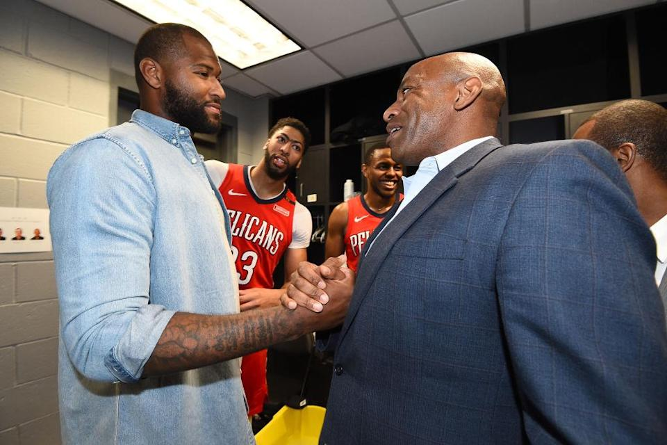 DeMarcus Cousins and Pelicans general manager Dell Demps shake hands after an April 2018 game against the Clippers. (Getty)