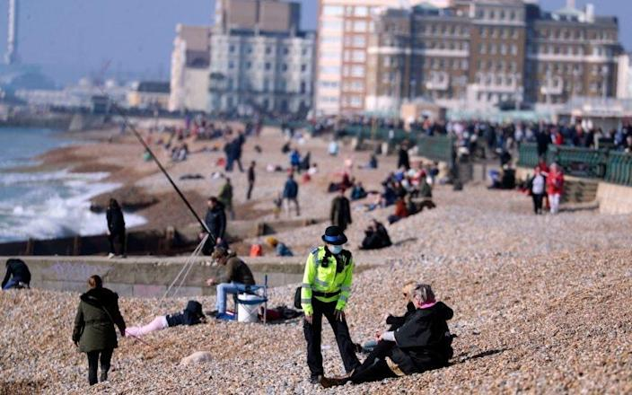 Police checked up on lockdown flouters during the weekend's unseasonably warm weather - PA