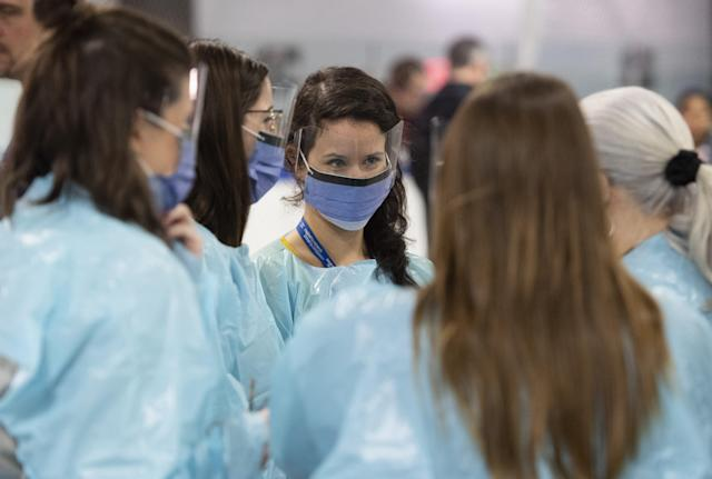 Medical staff prepare for the opening of the COVID-19 Assessment Centre at Brewer Park Arena in Ottawa, during a media tour on Friday, March 13, 2020. (THE CANADIAN PRESS/Justin Tang)