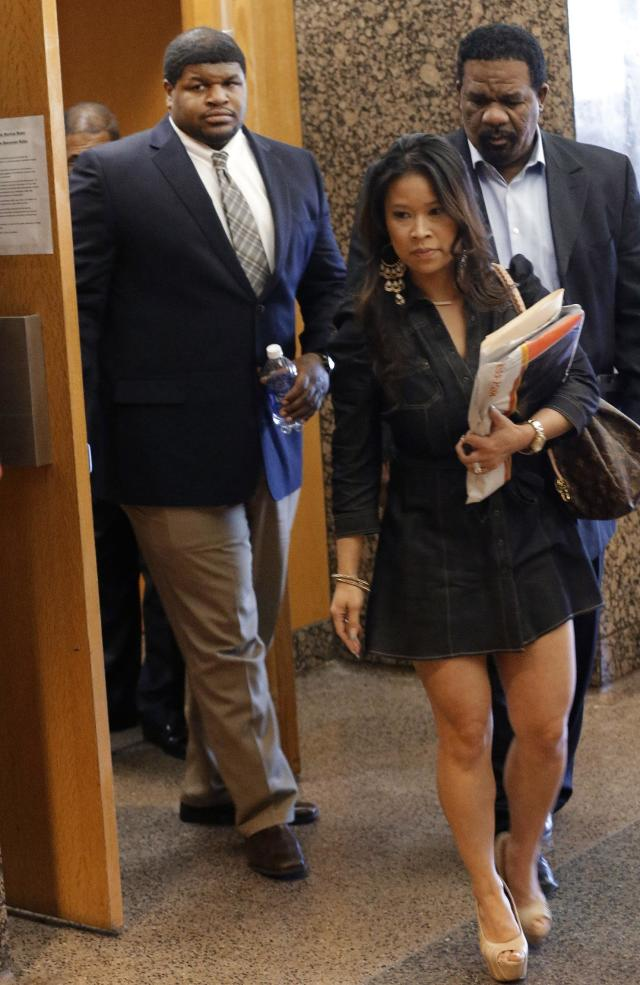 Former Dallas Cowboy Josh Brent, left, walks out of court with his legal team at the end of the day of testimony in his trial for intoxication manslaughter, Wednesday, Jan. 15, 2014, in Dallas. Brent is accused of driving drunk at the time of a December 2012 crash that killed Cowboys practice squad player Jerry Brown. (AP Photo/LM Otero)