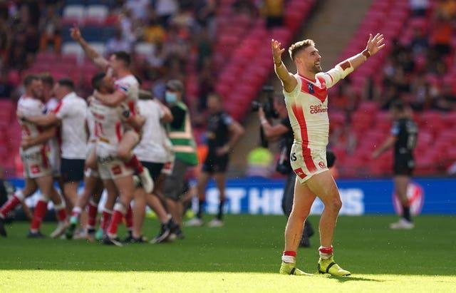 St Helens' Tommy Makinson celebrates at the end of the game