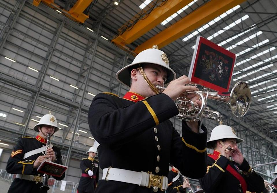 The Royal Marine Band play in The Venturer Building after a frigate steel cutting ceremony for the first of the class Type 31 frigate, at Babcock Rosyth, Fife (Andrew Milligan/PA) (PA Wire)