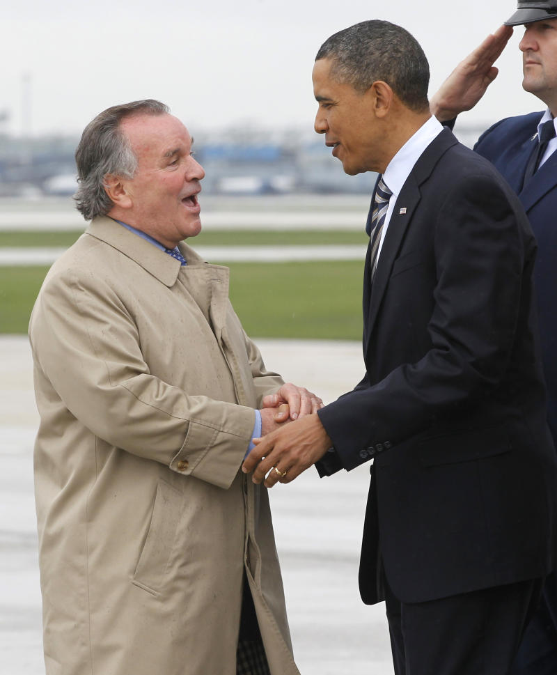 Chicago Mayor Richard M. Daley greets President Barack Obama upon his arrival in Chicago, Wednesday, April 27, 2011, to tape an interview with Oprah Winfrey.  (AP Photo/Charles Dharapak)