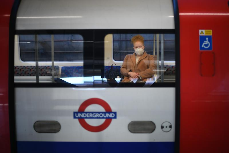 A commuter sits on an train at Canning Town underground station in London, after the announcement of plans to bring the country out of lockdown. (Photo by Victoria Jones/PA Images via Getty Images)