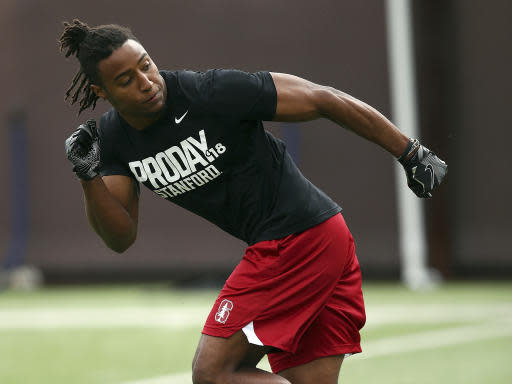 FILE - In this March 22, 2018, file photo, Stanford's defensive back Justin Reid runs a drill during Pro Day in Stanford, Calif. Reid of the Houston Texans used to frequent his older brothers house to watch NFL game film and study game preparations. The visits while he was at Stanford gave him a behind-the-scenes look at the NFL life of his older brother, Eric Reid, who was thriving with the San Francisco 49ers. (AP Photo/Ben Margot, File