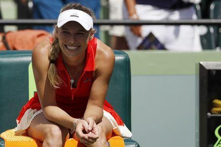 Mar 30, 2017; Miami, FL, USA; Caroline Wozniacki of Denmark smiles while sitting in her player's chair after her match against Karoilina Pliskova of the Czech Republic (not pictured) in a women's singles semi-final during the 2017 Miami Open at Crandon Park Tennis Center. Wozniacki won 5-7, 6-1, 6-1. Geoff Burke-USA TODAY Sports