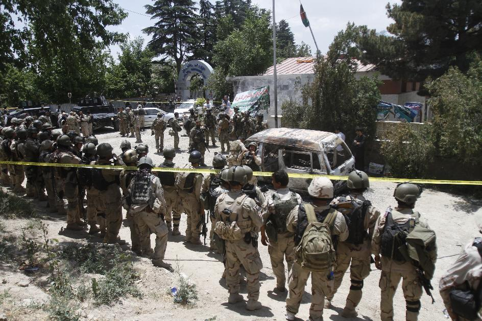 Afghan special forces are seen outside the Spozhmai hotel at Lake Qargha where security officials say Taliban insurgents have killed at least 17 people, most of them civilians, in an attack that began before midnight on Thursday, just north of Kabul, Afghanistan, Friday, June, 22, 2012. It was the latest in a string of attacks this week that suggest the insurgent group is pushing hard with its summer offensive rather than waiting for international forces to draw down. (AP Photo/Ahmad Jamshid)