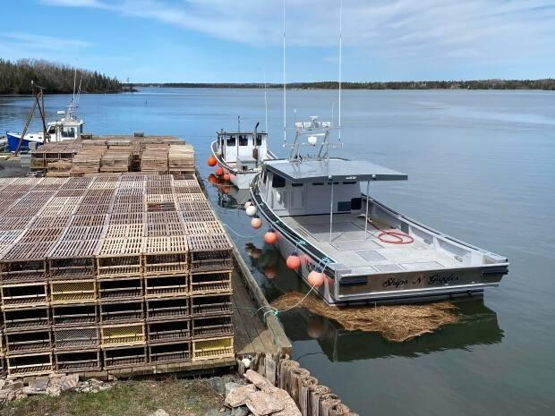 These lobster traps piled at Pinette wharf in southeastern P.E.I. won't be going into the water until at least Monday after the start of the spring season was delayed. (Carolyn Ryan/CBC - image credit)