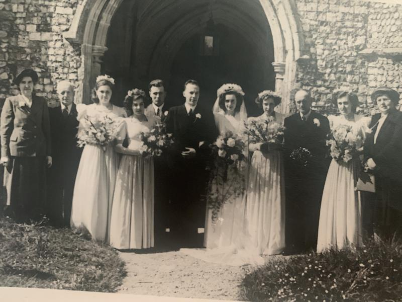 Les and Audrey, centre, at their wedding in 1951. [Photo: SWNS]
