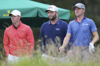 From left, Rory McIlroy, Jon Rahm and Justin Thomas attend day two of the Aberdeen Standard Investments Scottish Open at The Renaissance Club, North Berwick, Scotland. (Jane Barlow/PA via AP)