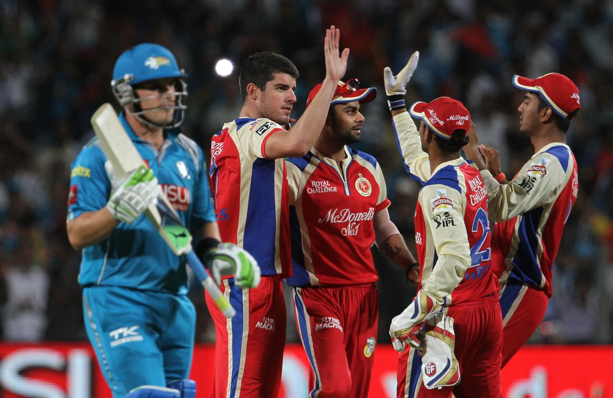 Royal Challengers Bangalore player Moises Henriques celebrates with his teammates after getting the wicket of Pune Warriors captain Aaron Finch during match 46 of the Pepsi Indian Premier League ( IPL) 2013  between The Pune Warriors India and the Royal Challengers Bangalore held at the Subrata Roy Sahara Stadium, Pune on the 2nd May 2013..Photo by Vipin Pawar-IPL-SPORTZPICS  ..Use of this image is subject to the terms and conditions as outlined by the BCCI. These terms can be found by following this link:..https://ec.yimg.com/ec?url=http%3a%2f%2fwww.sportzpics.co.za%2fimage%2fI0000SoRagM2cIEc&t=1493376690&sig=GZ23ptogUL5yTb_b4O2zZA--~C