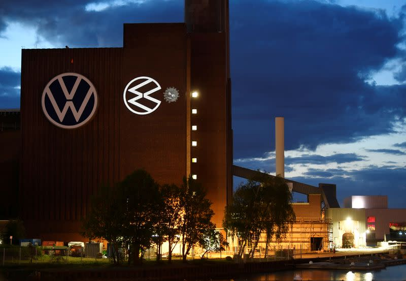 FILE PHOTO: A cartoon of a VW logo squashing the coronavirus is displayed on a building at Volkswagen's headquarters to celebrate the plant's re-opening during the spread of the coronavirus disease (COVID-19) in Wolfsburg