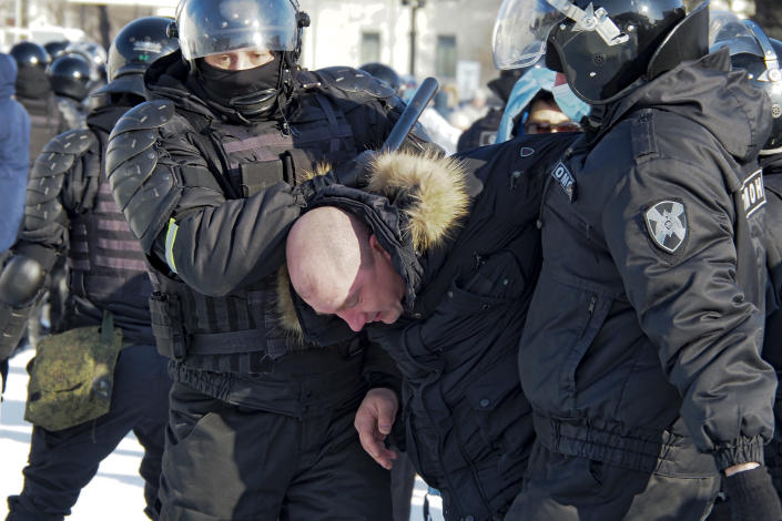 Police detain a man during a protest against the jailing of opposition leader Alexei Navalny in Khabarovsk, 6,100 kilometers (3,800 miles) east of Moscow, Russia, Saturday, Jan. 23, 2021. Authorities in Russia have taken measures to curb protests planned for Saturday against the jailing of Navalny. (AP Photo/Igor Volkov)