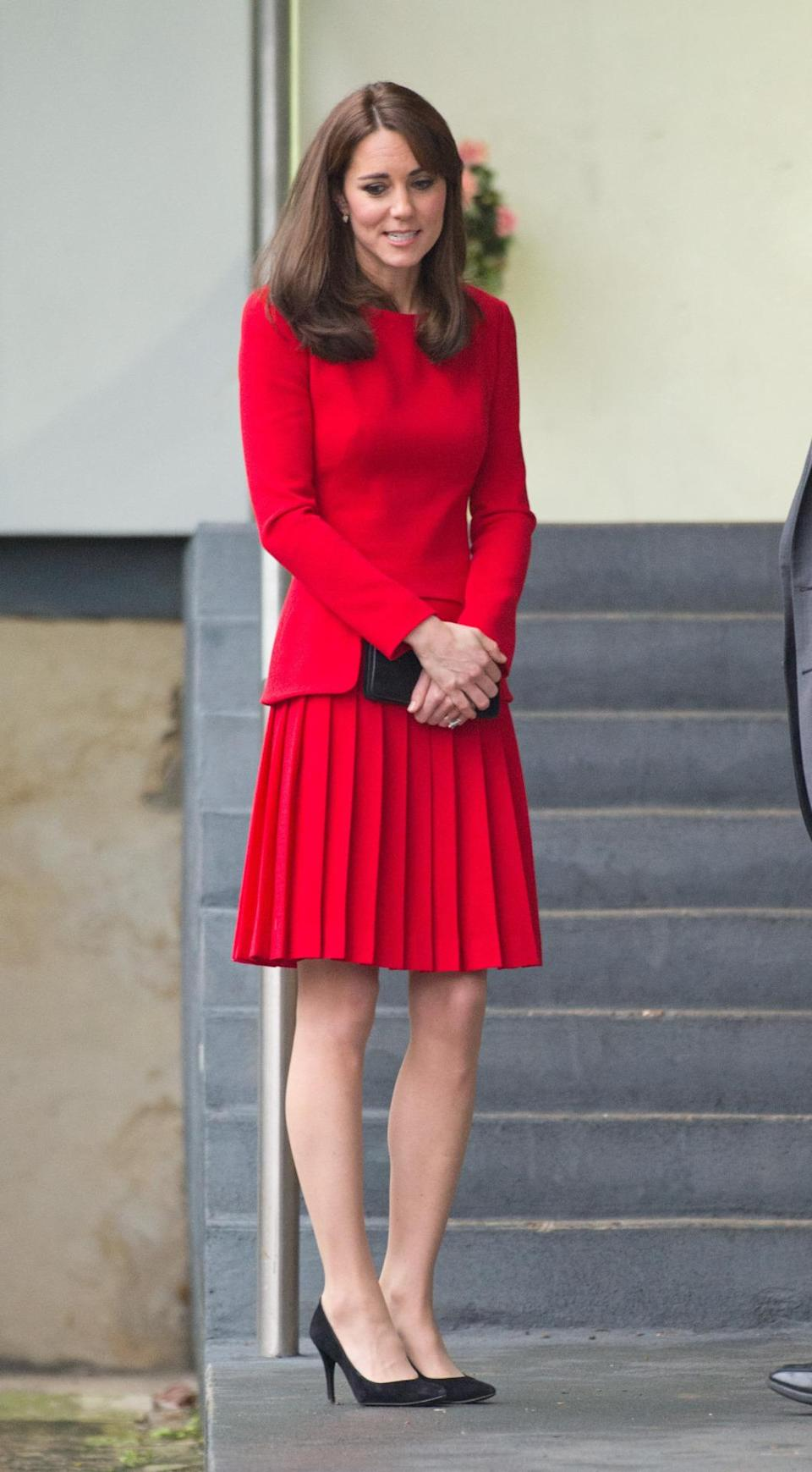 <p>Out for a Christmas lunch, Kate dressed in a vibrant red buttoned Luisa Spagnoli jacket and coordinating skirt with black Stuart Weitzman pumps. </p><p><i>[Photo: PA]</i></p>