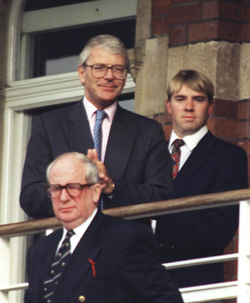 """FILE - In this Aug. 25, 1996 file photo, Britain's Prime Minister at the time, John Major watches play at the Oval as Pakistan played England in the third and final test between the two sides. For ex-British Prime Minister John Major, it was a no-brainer between the Olympics or cricket. While aids tried to persuade Major attending the 1996 games in Atlanta would be good for his """"street cred"""", he chose instead to watch cricket in London, missing the opportunity to see Britain's only gold Olympic medal that year. The details come as the UK government released a wave of archival records Tuesday, Dec. 31, 2019 following the law that certain records must be published thirty years after they were created. (David Cheskin/PA via AP, File)"""