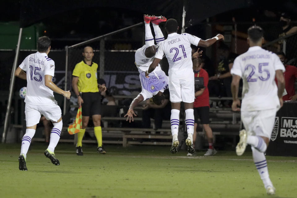 Orlando City celebrates after after their win against Minnesota United during an MLS soccer match, Thursday, Aug. 6, 2020, in Kissimmee, Fla. (AP Photo/John Raoux)
