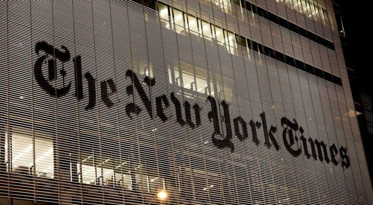 The headquarters of the New York Times (NYT) at night.