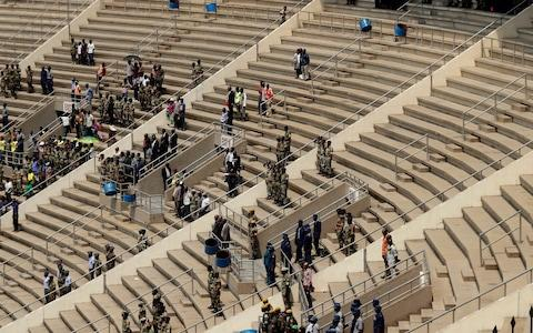 Large parts of the 60,000 seat stadium were empty during the ceremony  - Credit: Themba Hadebe/AP