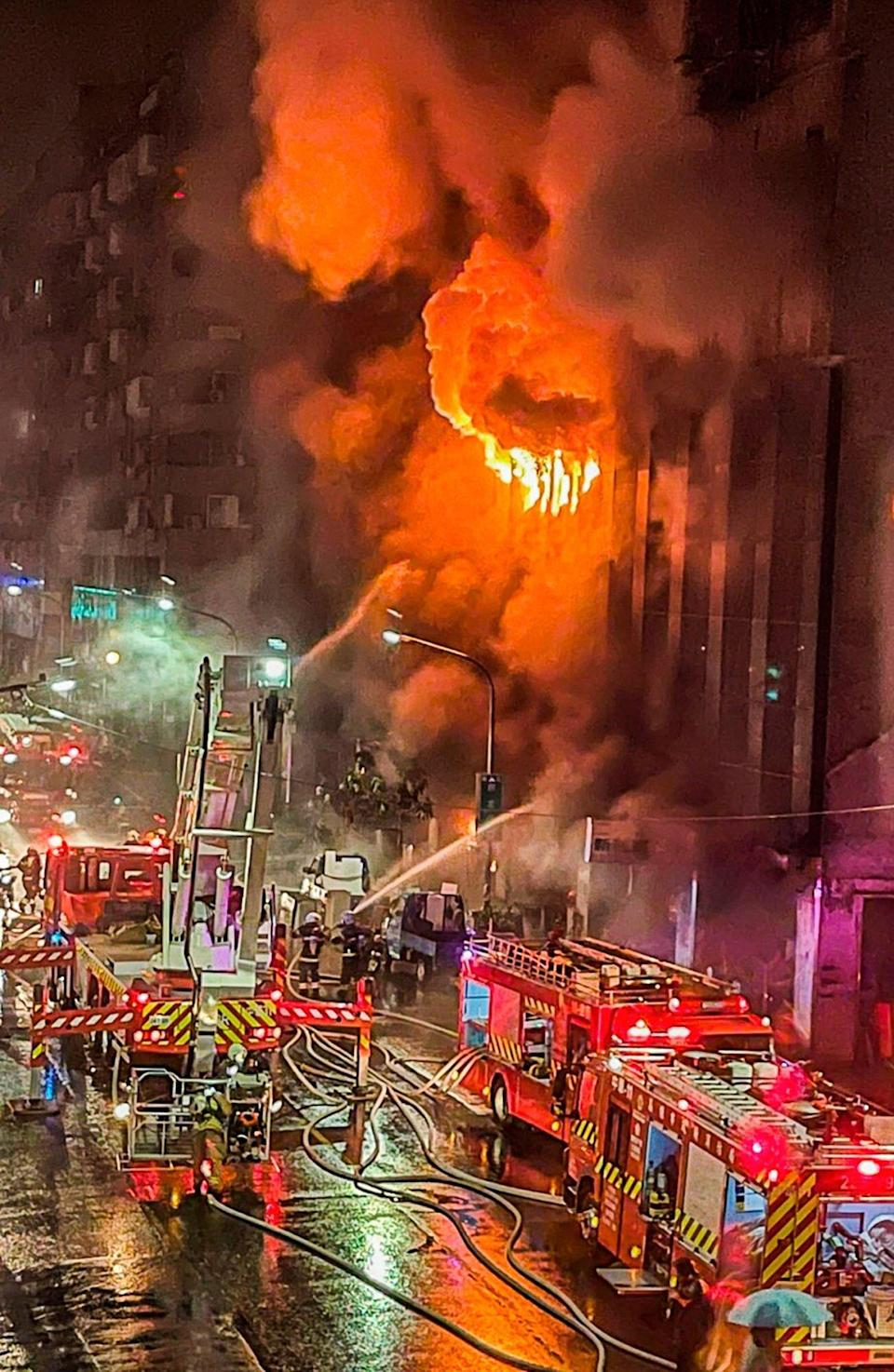 Firefighters battle a building fire in Kaohsiung