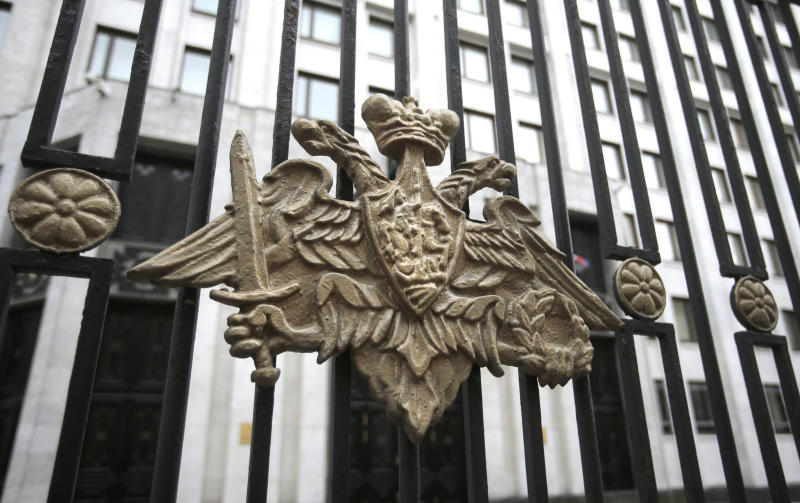 The emblem of the Russian Defense Ministry adorns the fence around the Defense Ministry's headquarters in Moscow, Russia, Thursday, Oct. 25, 2012. Russia's top investigative agency has launched a criminal probe into alleged fraud linked to the sell off of the Defense Ministry's assets. (AP Photo/Mikhail Metzel)