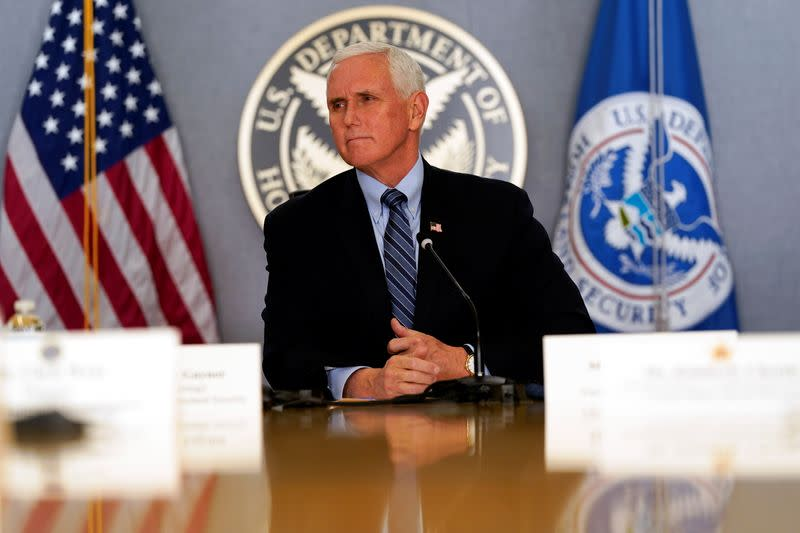 FILE PHOTO: Vice President Mike Pence listens during a briefing about the upcoming presidential inauguration of President-elect Joe Biden and Vice President-elect Kamala Harris, at FEMA headquarters