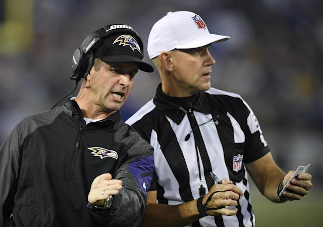 Baltimore Ravens head coach John Harbaugh, left, speaks with referee Clete Blakeman in the first half of an NFL preseason football game against the Washington Redskins, Saturday, Aug. 23, 2014, in Baltimore. (AP Photo/Nick Wass)