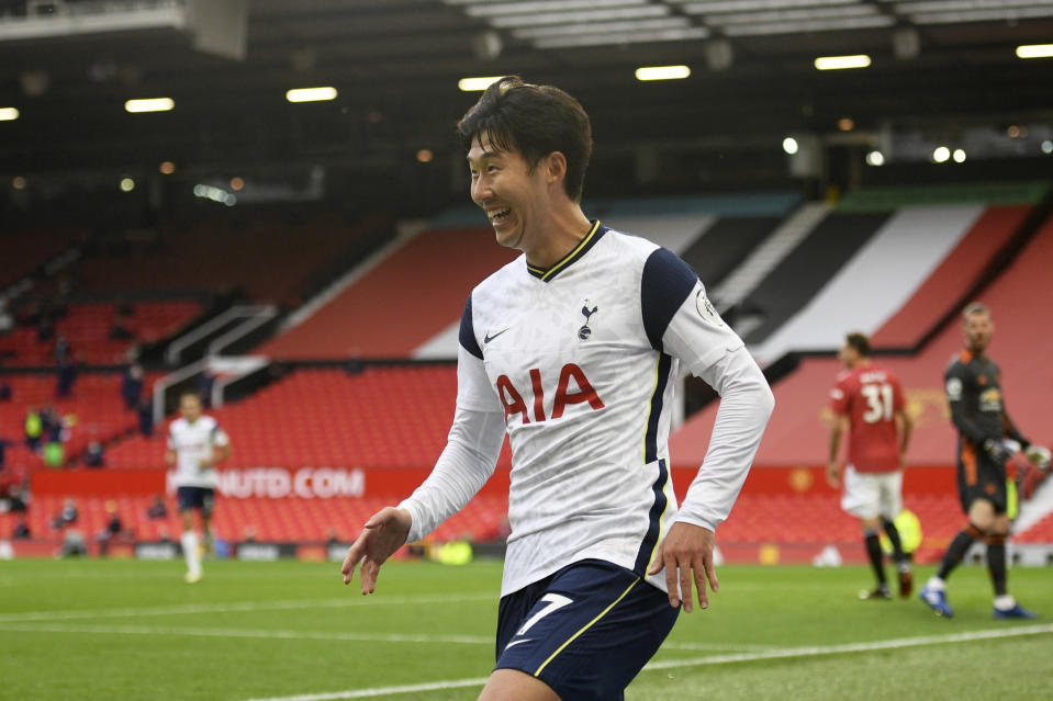 Tottenham's Son Heung-min celebrates after scoring his side's fourth goal during the English Premier League soccer match between Manchester United and Tottenham Hotspur at Old Trafford in Manchester, England, Sunday, Oct. 4, 2020. (Oli Scarff/Pool via AP)