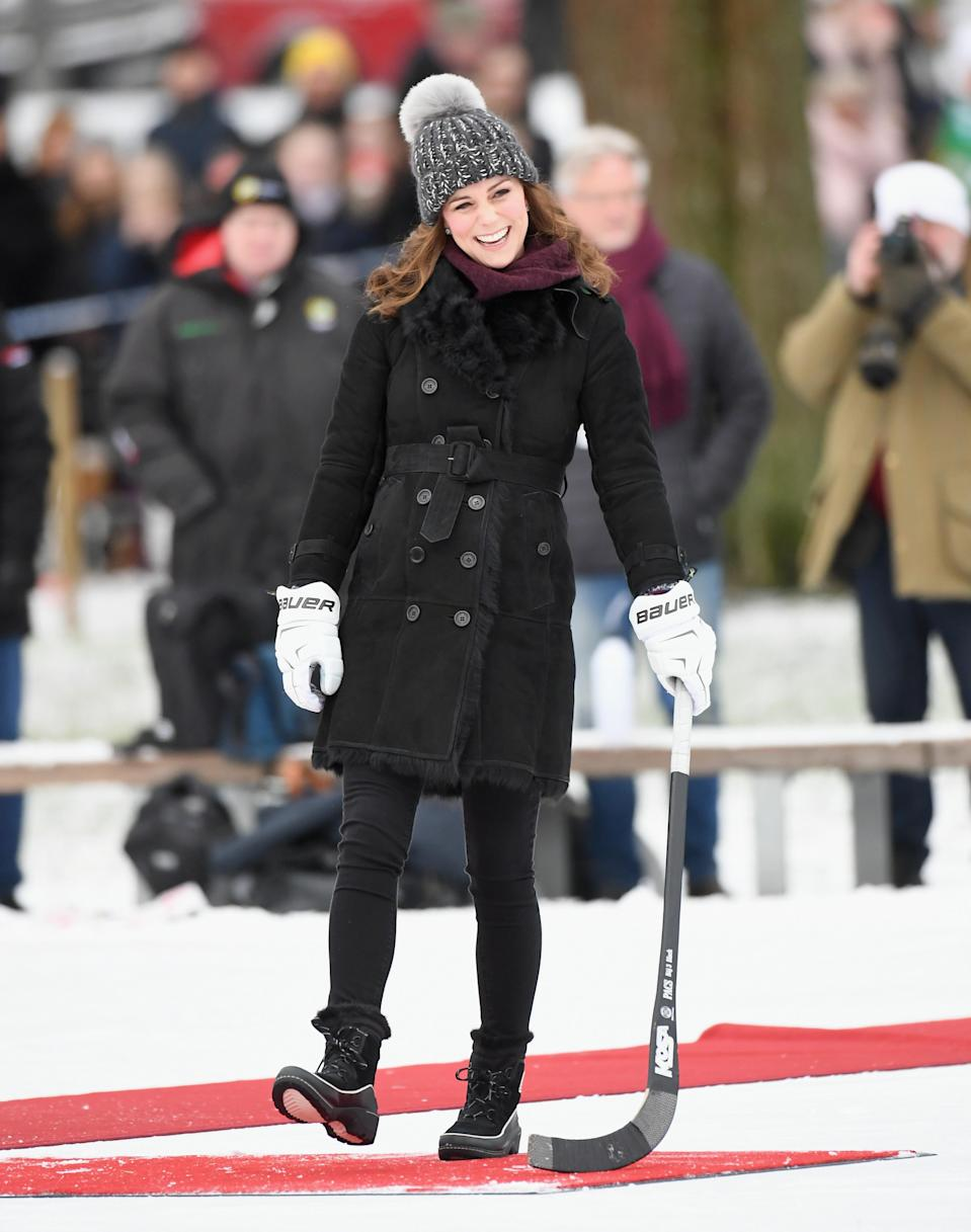 <p><strong>The occassion:</strong> At a hockey match in Stokholm during day one of the Duke and Duchess's Royal visit to Sweden and Norway.<br><strong>The look:</strong> A Burberry shearling coat with a jumper by Swedish label Fjallraven.<br>[Photo: Getty] </p>